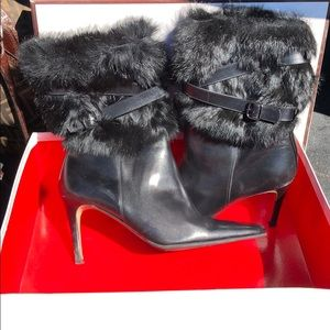 Coach high heel leather boots with fur